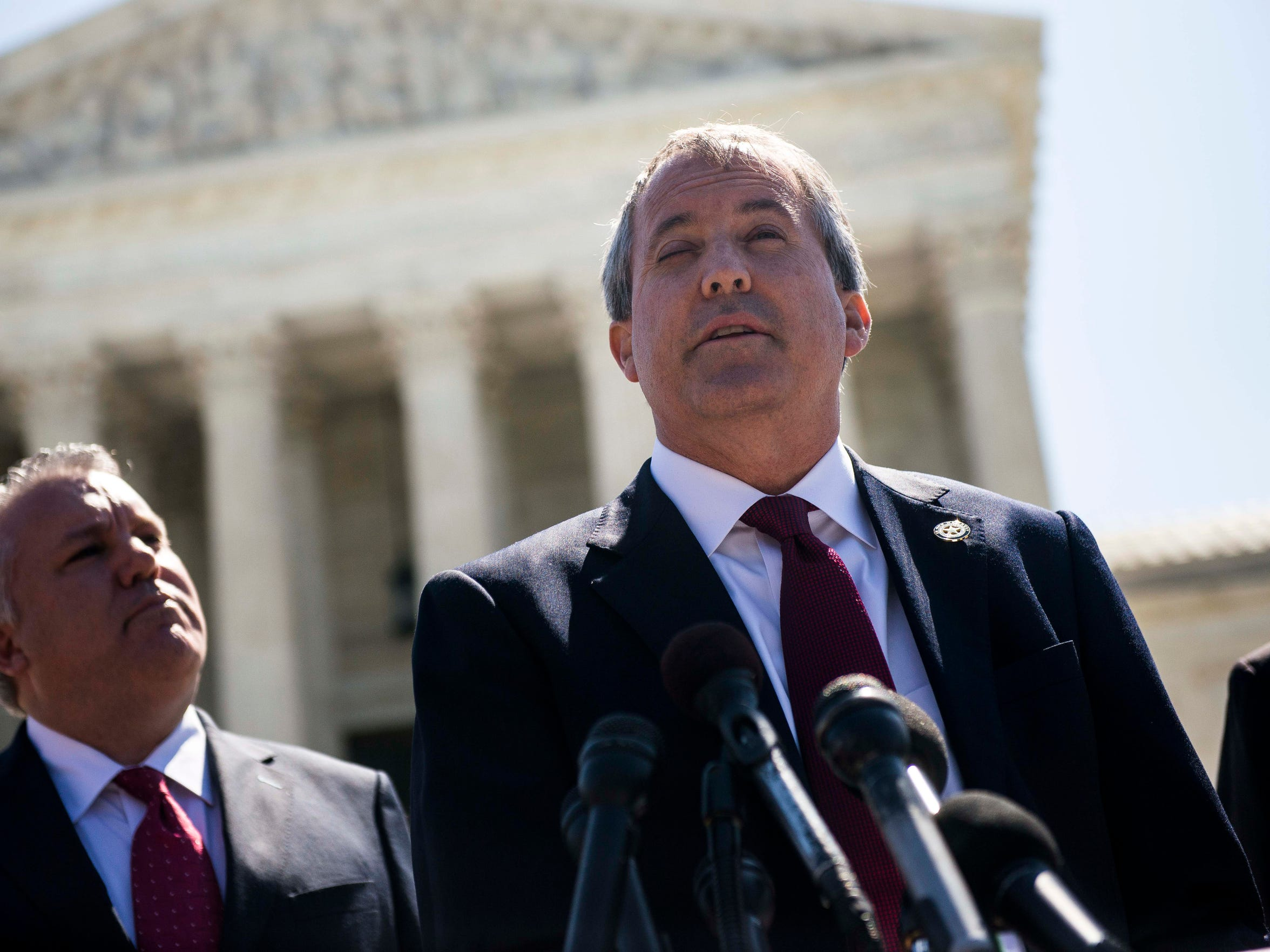 Texas Attorney General Ken Paxton speaks to reporters at a news conference outside the Supreme Court on Capitol Hill on June 9, 2016, in Washington, D.C. Paxton announced a lawsuit against the state of Delaware over unclaimed checks.