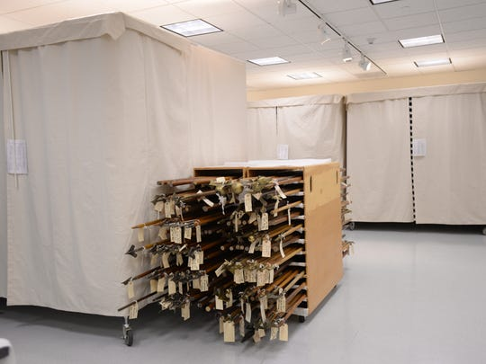 The storage facility at the State Historical Center in Lansing where 240 battle flags from the Civil War, Spanish American War and World War I, are stored pictured on Wednesday, June 22, 2016. In the center are historical flag poles.