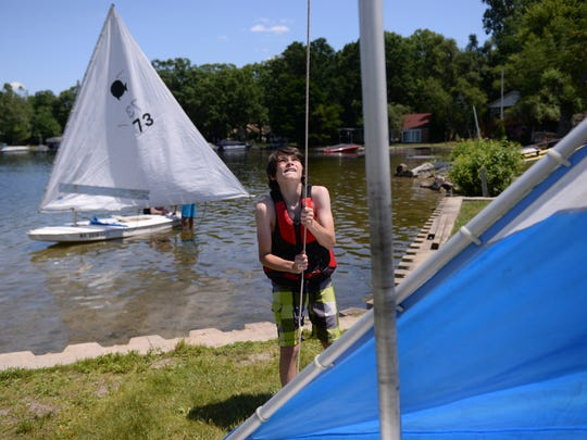 Lake Lansing in Meridian Township provides a plethora of water-based activities, including sailing and paddleboats.