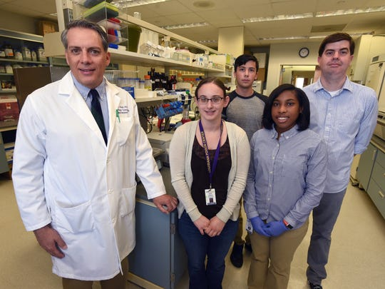Associate Professor Ronald Klein, Ph.D. poses with his team (left to right) graduate student Kasey Jackson, Airline High School student Erik Johnson, undergraduate student Demisha Porter and lab manager Robbie Dayton in their lab at LSU Health.