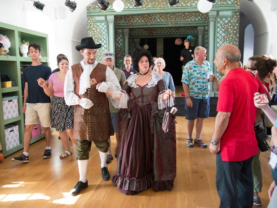 Costumed guides offer lessons in waltzing during a