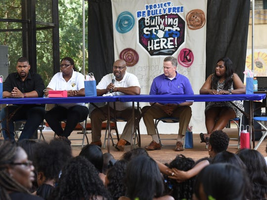 A panel discuss ways children should stear clear of bullies at school and what parents should look for if thier children are being bullied during the Project Be Bully Free End of Summer Jam at the Red River District Saturday.
