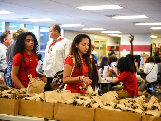 Vineland High School students pick up bag lunches due