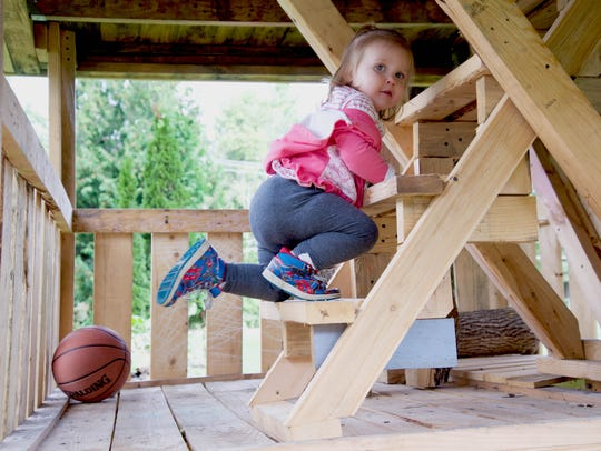 A 20-month-old Lydia Mead climbs to the third floor