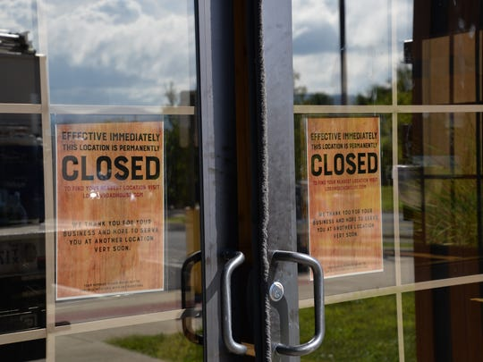 Signs hang on the doors of Logan's Roadhouse in Waynesboro.