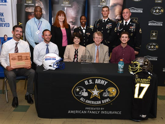 Dr. Nelson, standing far left, is joined by Superintendent of Schools Dr. Margaret Dolan, and Staff Sergeants Tanya Hodge, Tyler Negri, and Justin Arrant.  Seated following their acceptance of awards are Westfield High School Marching Band Assistant Director Trevor Sindorf and Director Christopher Vitale, Michael's parents Angela and Paul, and Michael Hauge.