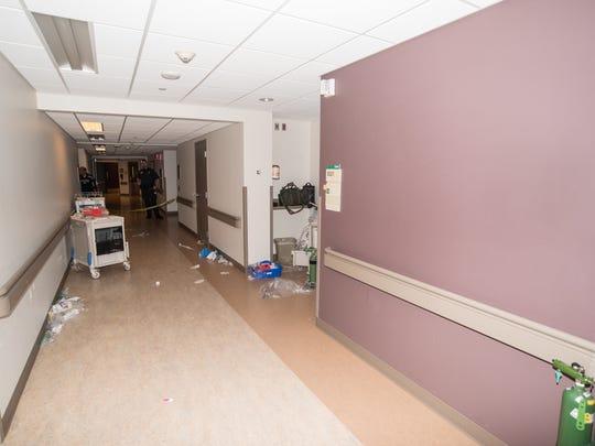 Medical equipment is seen outside the room where Danny Hammond shot investigator Steven Sandberg one year ago.