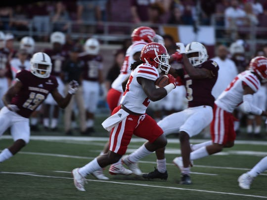 UL running back Darius Hoggins looks for open room during the Cajuns' 27-3 win over Texas State on Saturday night.