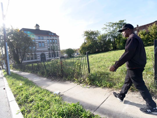 In Baltimore, Damian (Bert) McNeil works to prevent violence for the city health department's Safe Streets program in Baltimore's Park Heights section on Friday, Oct. 14, 2016. The program employs ex-offenders to mediate conflicts on the streets of their own neighborhoods.