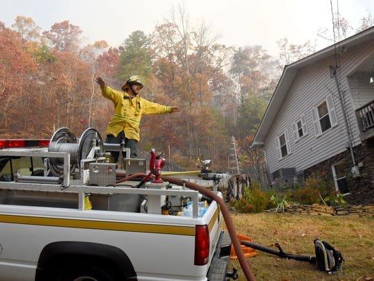 Fires burning along East Miller's Cove Rd in Walland Friday, Nov. 18, 2016. Curtis Cornett working to keep fire back from his home.