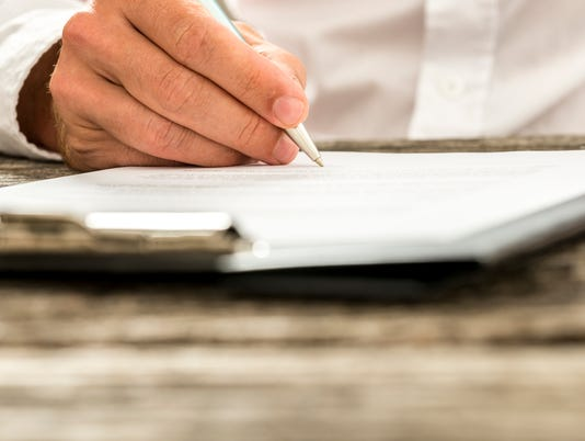Male hand signing subscription form, legal document or business contract