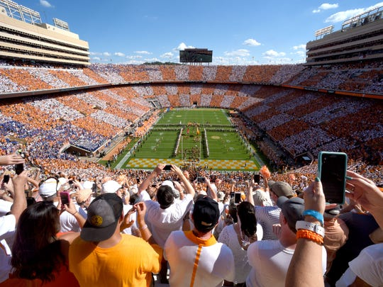 The University of Tennessee football team takes the field as the Pride of the Southland marching band performs a pregame show and fans checker Neyland Stadium orange and white for the Florida game on Saturday, Sept. 24, 2016.