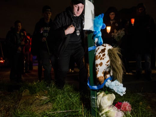 Hundreds mourn slain WSU officer at vigil