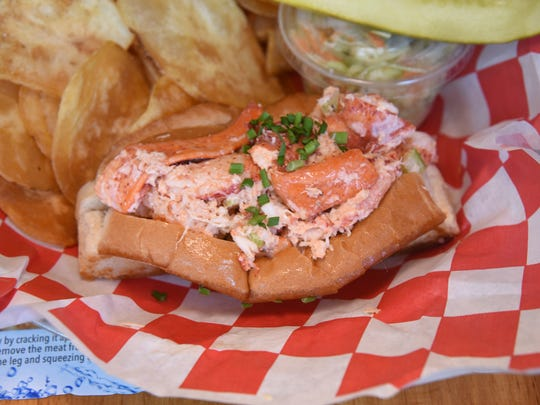 A Maine lobster roll at Jack's Lobster Shack in Edgewater comes with house-made sides: piquant coleslaw and crackling potato chips.