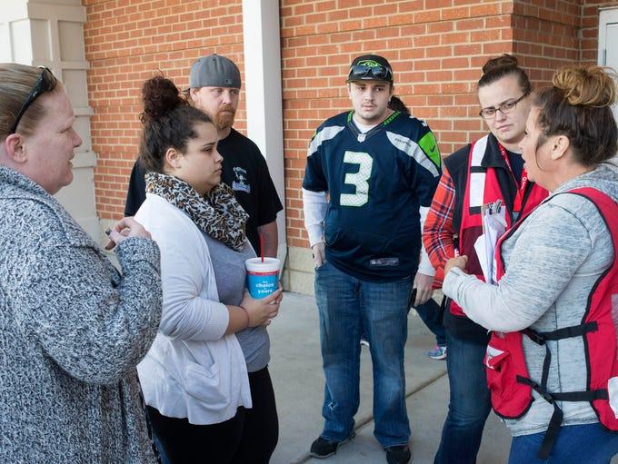 Karyssa Dalton, second from left, talks to Red Cross