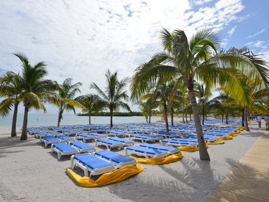 The beachfront area of Harvest Caye is lined with more