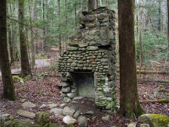 The chimney of a cabin is pictured the Sugarlands Valley Nature Trail on Monday, Dec. 19, 2016, in the Great Smoky Mountains National Park. The cabin remnants along the trail are from the 1920s and were judged not old enough to merit saving for historic value. The valley here once held more than 200 residences including small farms with apple orchids and planted fields, according to Brad Free, a Park Service ranger.