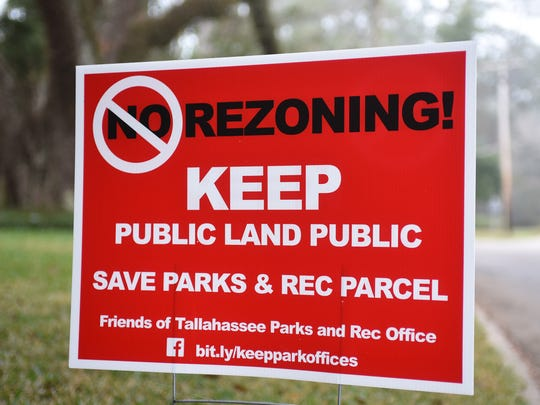 Many red yard signs sprouted in the Myers Park neighborhood opposing a zoning change that would have allowed the sale of city owned property at 912 Myers Park Drive. Earlier this year, the City Commission voted down the proposal.