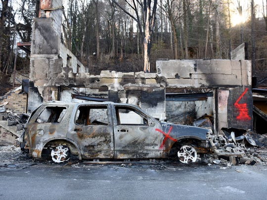 Scenes from downtown Gatlinburg on Friday, Dec. 2, 2016 after residents were allowed back in following the devastating fires on Monday night.