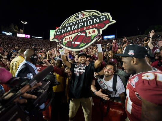 Rashad Greene celebrates after Florida State won its third national champinoship