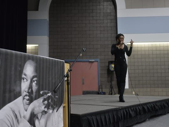 Area performer Tracy George, or Stafruit, performs at the St. Cloud NCAAP's Martin Luther King Freedom Fund dinner on Sunday.