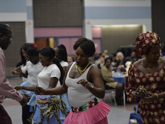 Members of the Acholi community perform traditional dances from South Sudan. The performance was apart of the St. Cloud NCAAP's Martin Luther King Freedom Fund dinner on Sunday.