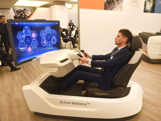 Cedric Ketels, Advanced Innovation Manager, Faurecia, demonstrates the Active Wellness 2.0 with monitors body management with data sensors to improve wellness levels on display in Detroit, Michigan