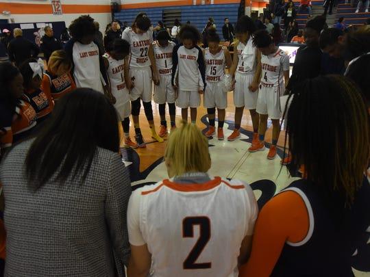 The Eastside girls team huddles up during a game last season.