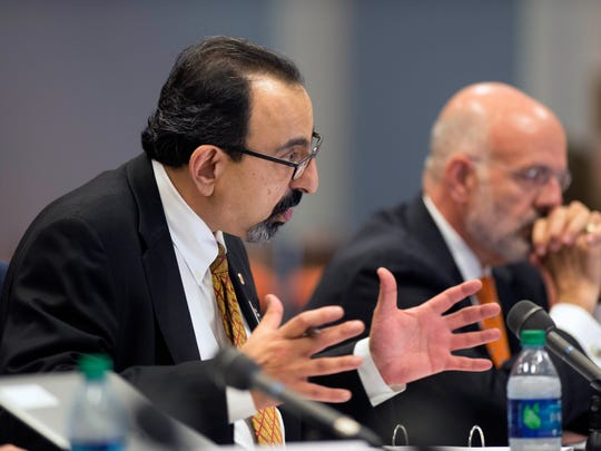 Vice Chairman Raja Jubran speaks during a Board of Trustees meeting Friday, Oct. 9, 2015, at the University of Tennessee. At right is Tennessee President Joe DiPietro.DiPietro asked the board of trustees on Friday, March 3, to limit his retreat salary to four years.  (PAUL EFIRD/NEWS SENTINEL)