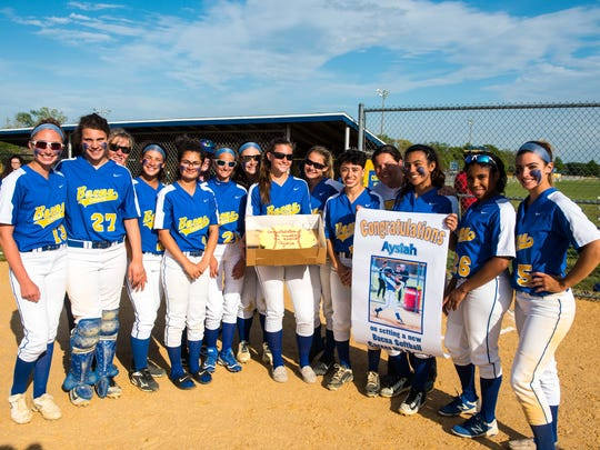 Buena third baseman Aysiah Cintron (10) is congratulated by teammates on hit number 143 for the all-time hits record for Buena while playing against Holy Spirit at Buena Regional High School on Wednesday, May 10.