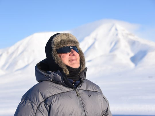 Michael Zeiler is photographed here at the Arctic archipelago of Svalbard, eager to get a look at a total solar eclipse in 2015.