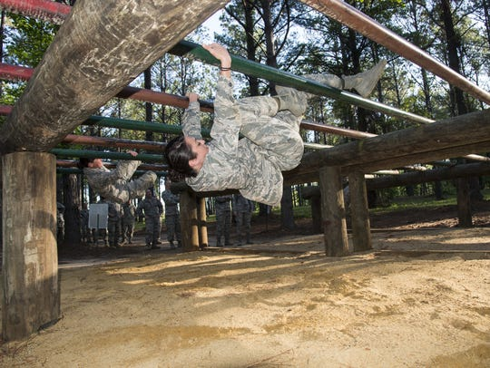 Commissioned Officer Training student maneuvers through