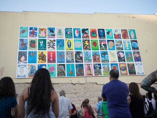 "A ceremony honoring the artists that took part in the ""Loteria"" mural drew crowds during the October 2015 Corpus Christi Art Walk."