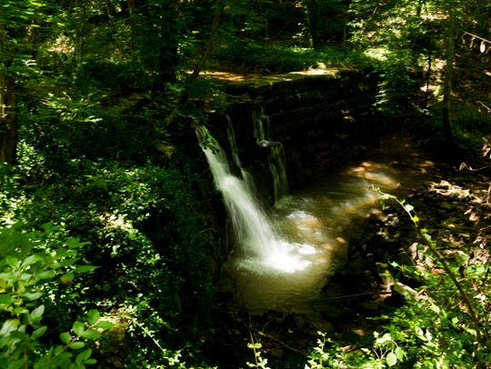 A waterfall inside a natural area of approximately