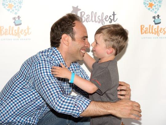 Frank DeBlasi hugs Cameron Naubereit at Ballsfest 2017.