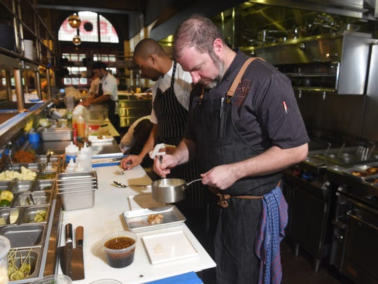 Thomas Lents, executive chef, works in the kitchen