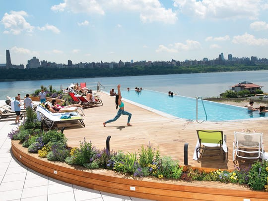 Maritza Dearing, yoga instructor, poses for photos by the infinity pool at SoJo Spa Club in Edgewater on Thursday June 01, 2017. Dearing teaches LIYA METHOD YOGA at SoJo.