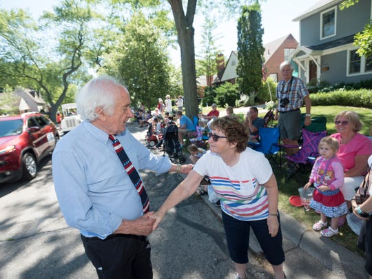 U.S. Representative Sander Levin, D-Royal Oak, chats with Judy Bateman of Huntington Woods as he walks the parade route.