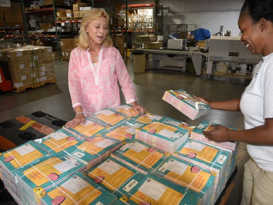 Ann Staup, owner of Direct Mail Services, talks to