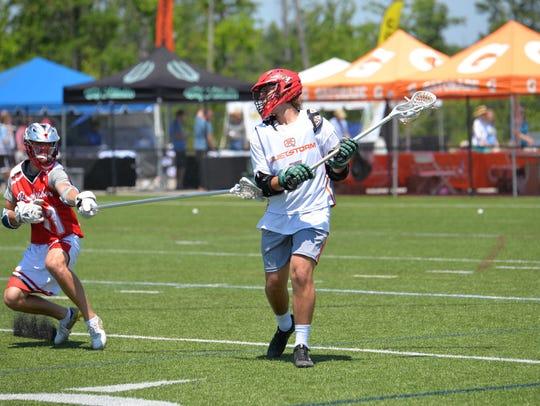 The Quiet Storm Lacrosse team participates in a regional