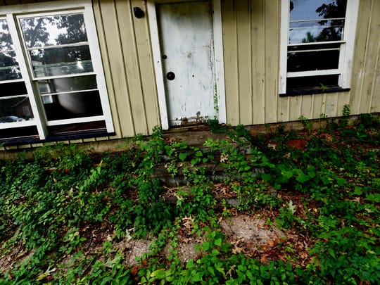 There are several abandoned homes in the Cedar Grove