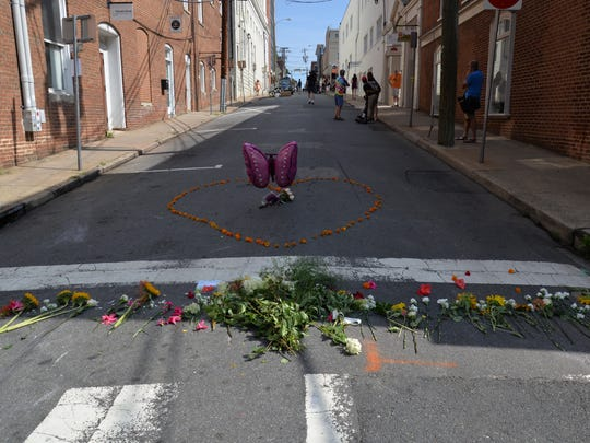 Flowers at the intersection of Fourth and Water streets in downtown Charlottesville on Sunday, Aug. 13, 2017. The day prior, a group of protesters was struck by a vehicle leaving on woman, Heather Heyer of Charlottesville, dead.