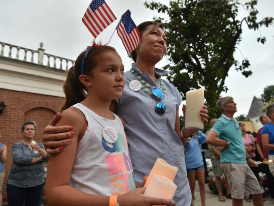 Lieso Staines and her daughter Anna, 9, attend a candlelight vigil as co-organizers Women for Progress and Glen Rock After the March host the vigil on Tuesday in solidarity with Charlottesville, Va.