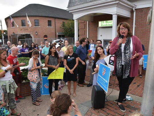 Freeholder Tracy Zur speaks at a candlelight vigil
