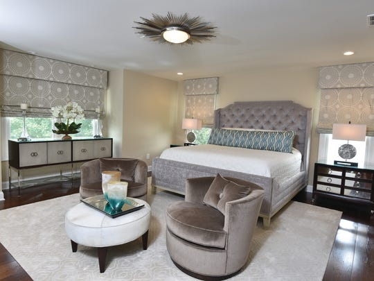 Muted colors with blue accents characterize the bedroom.