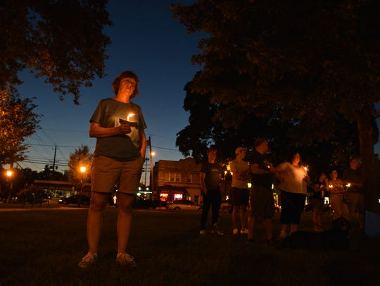 Karla Williams attends a peace vigil in Westwood in