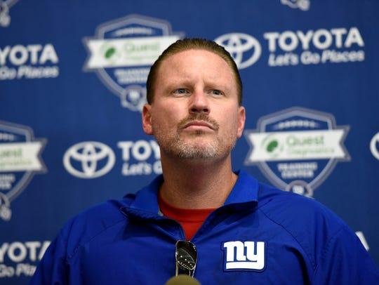 New York Giants head coach Ben McAdoo talks to the
