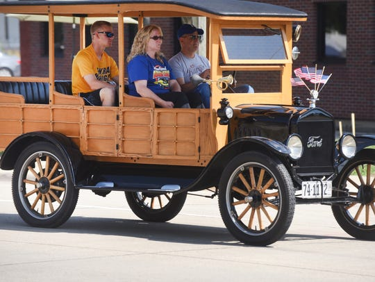 A Ford wagon with wooden spoke wheels at the Woodward