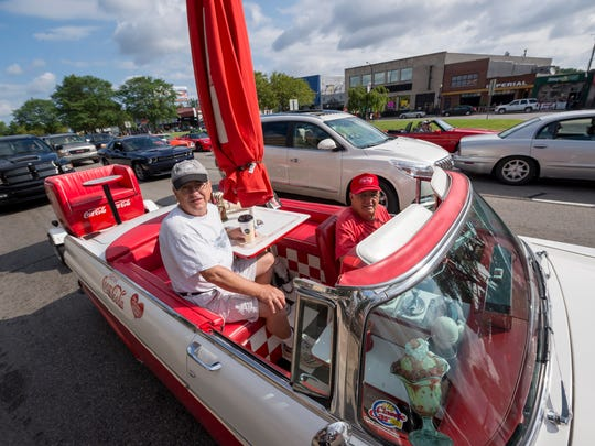 Bob Haas, of South Lyon, drives his Coca-Cola inspired 1955 Ford down Woodward.              Photos are of the Woodward Dream Cruise, in Ferndale, August 19, 2017.   (David Guralnick / The Detroit News)