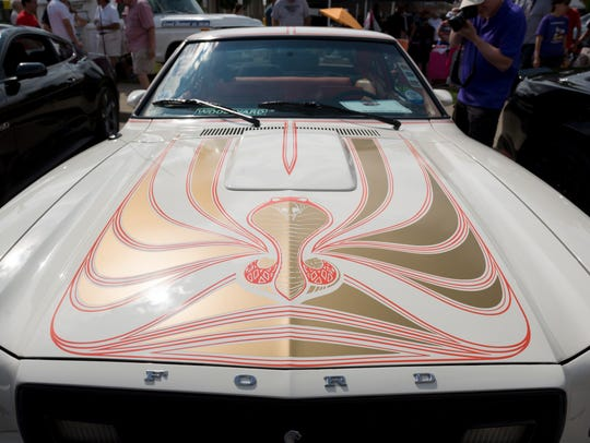 A painted hood of a 1978 Ford Mustang King Cobra owned